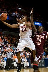 Virginia guard Sean Singletary (44) shoots past Virginia Tech forward/center Cheick Diakite (34).  The Virginia Cavaliers men's basketball team fell to the Virginia Tech Hokies 70-69 in overtime at the John Paul Jones Arena in Charlottesville, VA on January 16, 2008.