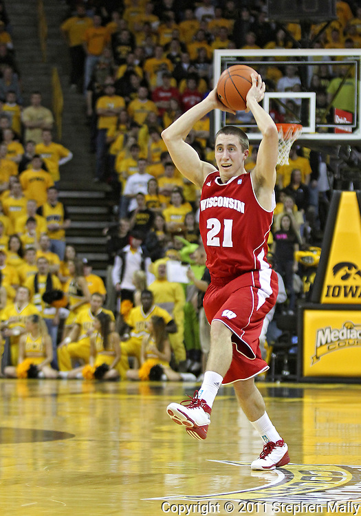 February 09 2011: Wisconsin Badgers guard Josh Gasser (21) looks to pass during the first half of an NCAA college basketball game at Carver-Hawkeye Arena in Iowa City, Iowa on February 9, 2011. Wisconsin defeated Iowa 62-59.