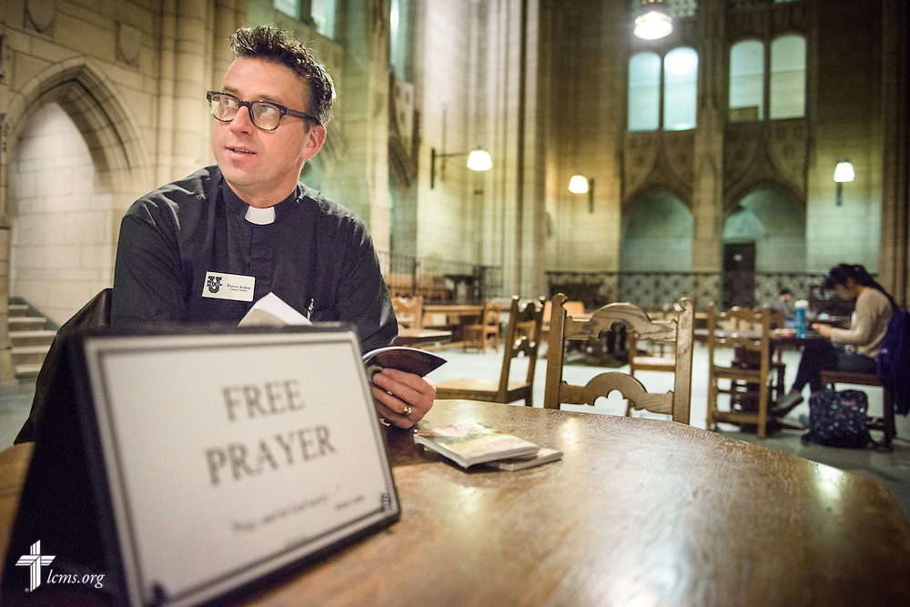 """The Rev. Eric R. Andræ, associate pastor for campus and international ministry at First Trinity Evangelical–Lutheran Church and Luther House student center, watches for students with his """"free prayer"""" sign in the Gothic Revival skyscraper known as the Cathedral of Learning on the campus of the University of Pittsburgh on Saturday, Nov. 19, 2016, in Pittsburgh. LCMS Communications/Erik M. Lunsford"""