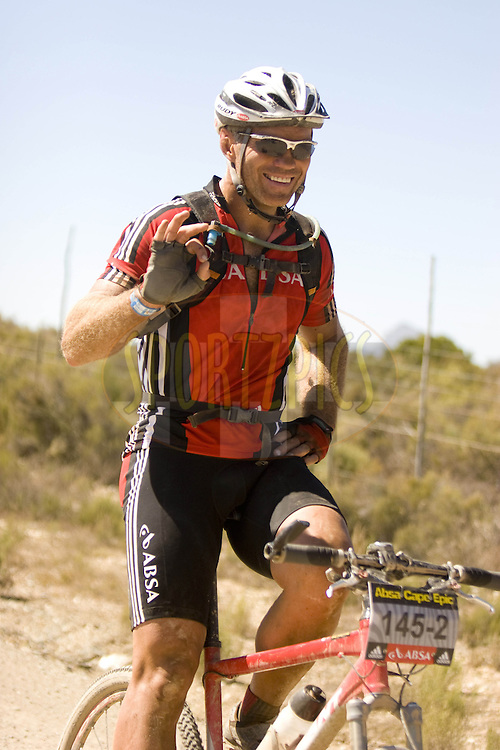 WESTERN CAPE, SOUTH AFRICA -  31 March 2008,Tiaan Strauss during stage three of the 2008 Absa Cape Epic Mountain Bike stage race from Calitzdorp Spa.to Langenhoven High School in Riversdale, Western Cape, South Africa..Photo by Karin Schermbrucker/SPORTZPICS