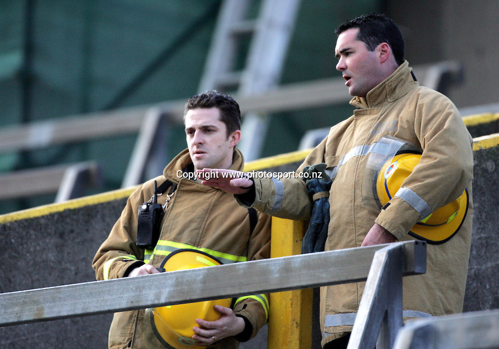 Irish Firemen survey the scene on the terraces of Landsdowne rd after a fire yesterday.All Blacks versus Ireland Rugby Union match at Landsdowne Road, Dublin, Saturday 12 November 2005.The All Blacks won the match 45-7.Photo: Andrew Cornaga/Photosport.