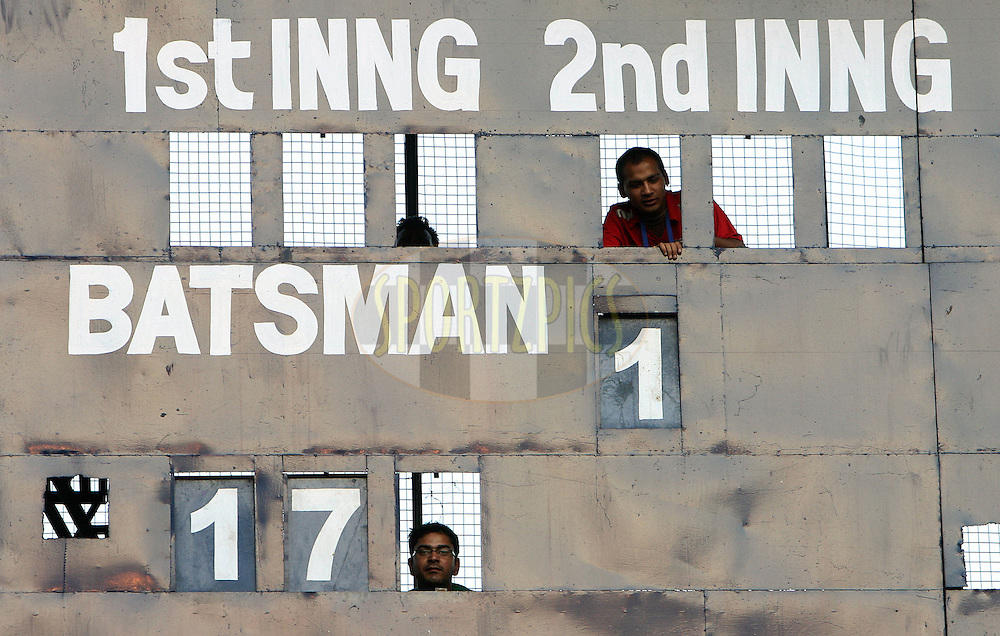 People working behind scoreboard during match 9 of the Indian Premier League ( IPL ) Season 4 between the Kings XI Punjab and the Chennai Super Kings held at the PCA stadium in Mohali, Chandigarh, India on the 13th April 2011..Photo by Money Sharma/BCCI/SPORTZPICS