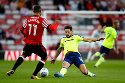 Jacob Butterfield of Derby County tackles Lewis Grabban of Sunderland - Mandatory by-line: Matt McNulty/JMP - 04/08/2017 - FOOTBALL - Stadium of Light - Sunderland, England - Sunderland v Derby County - Sky Bet Championship