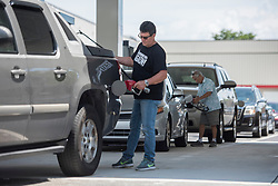 September 5, 2017 - West Palm Beach, Florida, U.S. - CARLOS PEREZ, 55, of Lake Worth, refuels his truck at the Lantana Road Costco in Lake Worth, Fla., on Tuesday. Perez said had mostly finished preparing for the hurricane, but shortages meant he couldn't find plywood or propane. Hundreds of residents waited in long lines to fill car tanks and spares with gas. (Credit Image: © Andres Leiva/The Palm Beach Post via ZUMA Wire)