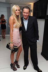PETRA ECCLESTONE and JAMES STUNT at The Reuben Foundation and Virgin Unite Haiti Fundraising dinner held at Altitude 360 in Millbank Tower, London on 26th May 2010.