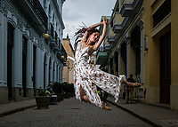 HAVANA, CUBA - CIRCA JANUARY 2020: Ballerina in  the streets of Havana, with Capitol building behind.