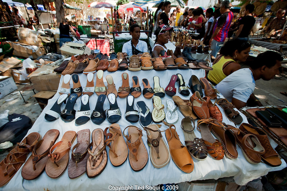 Street vendor selling shoes in downtown Havana.
