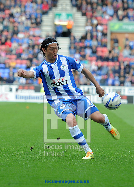 Roger Espinoza of Wigan Athletic in action against Blackpool during the Sky Bet Championship match at the DW Stadium, Wigan.<br /> Picture by Alan Wright/Focus Images Ltd 07733 196489<br /> 26/04/2014