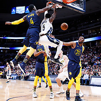 03 April 2018: Denver Nuggets forward Will Barton (5) dunks the ball past Indiana Pacers guard Victor Oladipo (4) during the Denver Nuggets 107-104 victory over the Indiana Pacers, at the Pepsi Center, Denver, Colorado, USA.