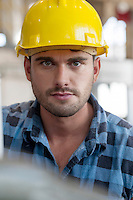 Portrait of confident young male worker in industry
