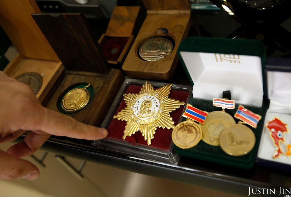 VivaCell- Armenia CEO Ralph Yirikian points to his medals at his office headquarters in Yerevan, the capital of Armenia.