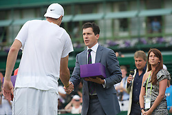 LONDON, ENGLAND - Thursday, June 24, 2010: Tim Henman presents John Isner (USA) with a gift after the historic longert game ever that lasted 11 hours and five minutes over three days. He beat Nicolas Mahut with the final score of 6-4 3-6 6-7 (7-9) 7-6 (7-3) 70-68 on day four of the Wimbledon Lawn Tennis Championships at the All England Lawn Tennis and Croquet Club. (Pic by David Rawcliffe/Propaganda)