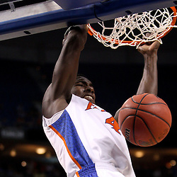 Mar 19, 2011; Tampa, FL, USA; Florida Gators forward/center Patric Young (4) dunks against the UCLA Bruins during first half of the third round of the 2011 NCAA men's basketball tournament at the St. Pete Times Forum.  Mandatory Credit: Derick E. Hingle