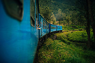 A train cuts its way through mountains and tea plantations in hill country, Ella, Sri Lanka, Asia