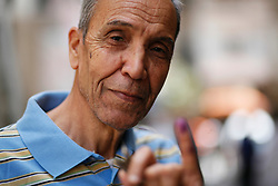 """I'm extremely happy my voice and my vote count in choosing who's going to rule Egypt. I hope that we'll see better days ... and that our problems will be solved. I always voted ... but I didn't feel it counted when Hosni Mubarak would take 99 per cent."" - Abdel Moneim Akl, 75"