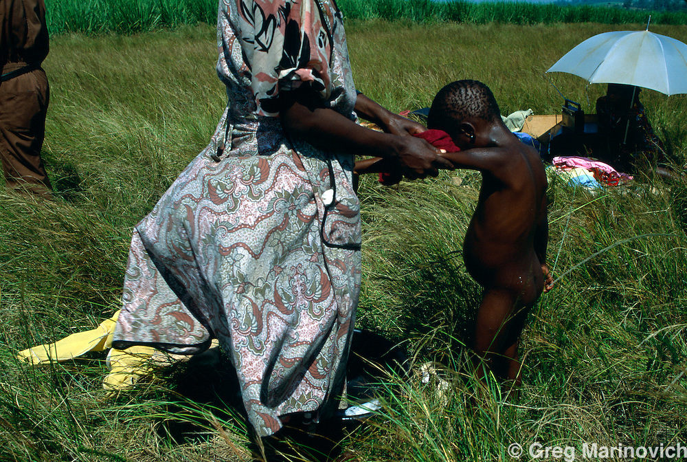 Sonkombo, KwaZulu Natal, 1994, South Africa: A family in a refugee camp for  ANC supporting families who fled from the Sonkombo area from which they had fled months earlier because of attacks by rival IFP.