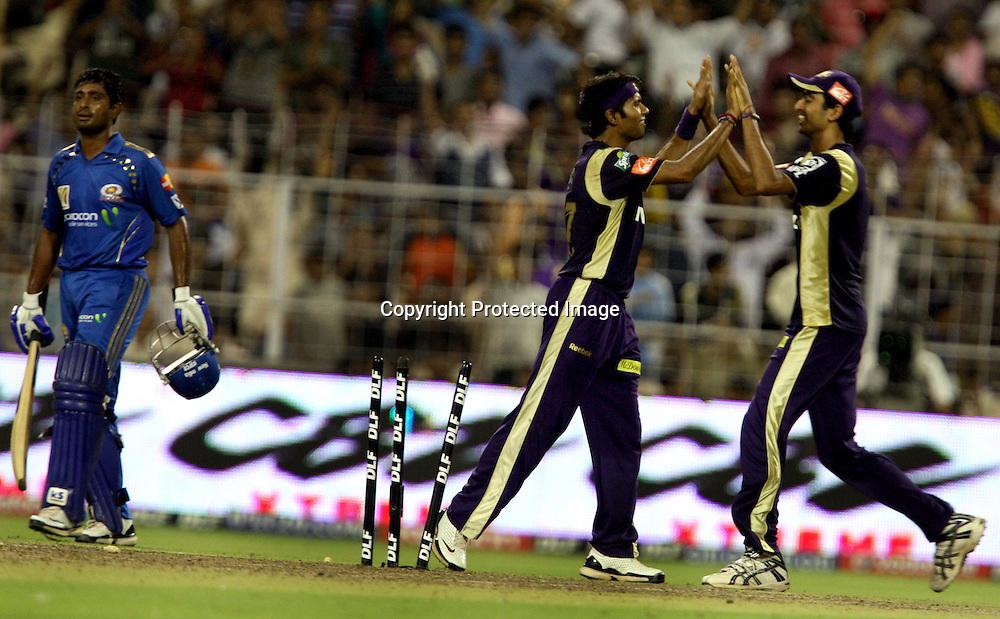 Kolkata Knight Riders Bowler Ashok Dinda Celebrates With Team Mate Mumbai Indians Batsman Ambati Rayudu Run Out During The  Indian Premier League - 56th match Twenty20 match | 2009/10 season Played at Eden Gardens, Kolkata 19 April 2010 - day/night (20-over match)