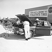 Studebaker's fleet of cars is being prepared for a speed record campaign at the Bonneville Salt Flats in October of 1963.