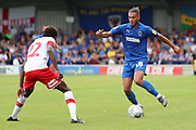 AFC Wimbledon defender Nesta Guinness-Walker (18) taking on Rotherham United defender Matthew Olosunde (22) during the EFL Sky Bet League 1 match between AFC Wimbledon and Rotherham United at the Cherry Red Records Stadium, Kingston, England on 3 August 2019.