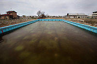 There was still a swimming pool filled with dirty water on playground of Minato elementary school in Ishinomaki city.