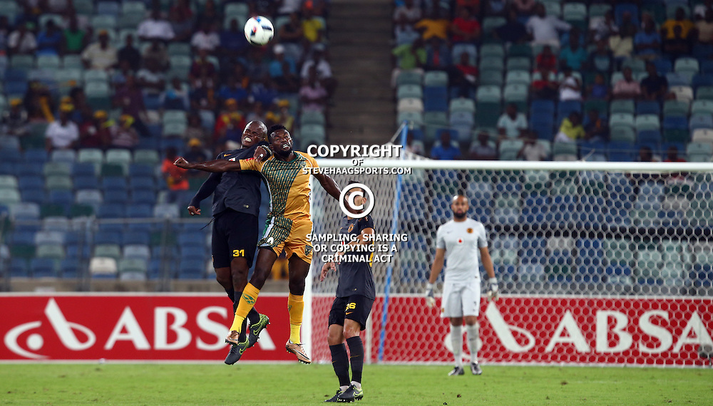 DURBAN, SOUTH AFRICA, February 2 2016 -Willard Katsande of kaizer chiefs and MWAPE MUSONDA of Golden Arrows both jump to head the ball during the PSL Absa Premiership Match Golden Arrows vs Kaizer Chiefs at the Moses Mabhida Stadium in Durban, South Africa. (Photo by Steve Haag)<br /> Images for social media must have consent from Steve Haag