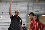 Southern California Trojans sprints coach Quincy Watts (left)talks with Kyra Constantine (center) and Kaelin Roberts during a training session prior to the NCAA Indoor Track & Field Championships in Birmingham, Ala., Thursday, May 7, 2019.