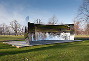 Anish Kapoor, C-Curve 2007,Stainless steel, 220 x 770 x 300 cm. Installation view of Serpentine Gallery exhibition Turning the World Upside Down, Kensington Gardens, London 28 September 2010 - 13 March 2011