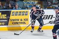 KELOWNA, CANADA - JANUARY 22: Dylan Coghlan #10 of Tri City Americans skates with the puck against the Kelowna Rockets on January 22, 2016 at Prospera Place in Kelowna, British Columbia, Canada.  (Photo by Marissa Baecker/Shoot the Breeze)  *** Local Caption *** Dylan Coghlan;