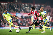 Brentford (19) Romaine Sawyers, Derby County (14) Andre Wisdom  during the EFL Sky Bet Championship match between Brentford and Derby County at Griffin Park, London, England on 26 September 2017. Photo by Sebastian Frej.