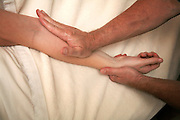 Massage of forearm flexor muscles during Swedish massage session