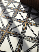 Indus, a stone water jet mosaic, shown in tumbled Nero Marquina, honed Thassos, and brushed Brass. Designed by James Duncan for New Ravenna.