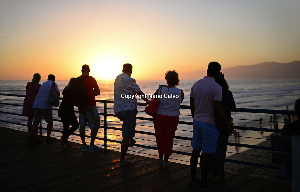 People in Santa Monica pier at sunset. Los Angeles, California.
