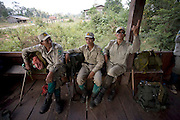 Rangers wait to be picked up after a four day patrol in the forest.The forest rangers are employed by the Ministry of Environment but sponsored by Flora and Fauna International who pays them 75% of their salary and provides training and accommodation. They undertake regular patrols in to the Samkos Wildlife Sancturary which is part of the Cardamom Mountains Nature Reserve looking for illegal activites such as logging, poaching, land encroachment and the production of the illegal substance sassafras oil. The Cardamom Mountains and surrounding forests is the largest and most pristine area of intact forest in SE Asia. Covering an area of 2.5 million acres it became one of the last strong holds of a retreating Khmer Rouge. Their presence helped preserve the forest as no-one dared to venture inside. But with the Khmer Rouge gone, it faces new dangers from poachers, loggers and illegal drug factories. In charge of protecting this vast forest are a handful of rangers who's job it is to track down and arrest those who are helping to destroy this delicate habitat.