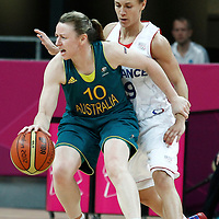 30 July 2012: Kristi Harrower of Australia holds the hand of Celine Dumerc of France while dribbling during the 74-70 Team France overtime victory over Team Australia, during the women's basketball preliminary, at the Basketball Arena, in London, Great Britain.
