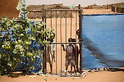 Children play hide and seek from western visitors to the 4 sq km Abu Shouk refugee camp, which is  (disputedly) home to 38,000 displaced persons, on the outskirts of Al Fasher, North Darfur, Sudan.