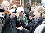 """Scott Smith (left) takes a picture of Hillary Clinton (right) after asking her a question before she goes into a """"Roundtable Discussion On Home Foreclosure Crisis"""" at the Fair River Oaks Council (FROC) office in Dayton, Thursday, February 14, 2008."""