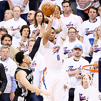 06 May 2016: Oklahoma City Thunder guard Russell Westbrook (0) takes a jump shot over San Antonio Spurs guard Danny Green (14) during the San Antonio Spurs 100-96 victory over the Oklahoma City Thunder, during Game Three of the Western Conference Semifinals of the NBA Playoffs at the Chesapeake Energy Arena, Oklahoma City, Oklahoma, USA.