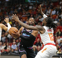 November 27, 2018 - Miami, FL, USA - Miami Heat's Dwyane Wade struggles to get around Atlanta Hawks' Taurean Prince in the second quarter on Tuesday, Nov. 27, 2018 at the AmericanAirlines Arena in Miami, Fla. (Credit Image: © Charles Trainor Jr/Miami Herald/TNS via ZUMA Wire)