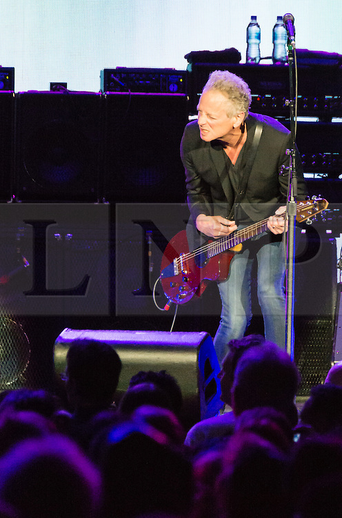 © Licensed to London News Pictures. 27/05/2015. London, UK.   Fleetwood Mac performing live at The O2 Arena, together with Christine Mc Vie who has rejoined the band.   In this picture - Lindsey Buckingham interacting with an audience member.  The band are due to headline the Isle of Wight Festival next month. Fleetwood Mac are a British-American rock band consisting of members Mick Fleetwood (drums), John McVie (bass guitar), Christine McVie (keyboards/vocals), Lindsey Buckingham (guitars, vocals), Stevie Nicks (vocals, tambourine).  Photo credit : Richard Isaac/LNP