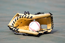 SAN FRANCISCO, CA - APRIL 11:  Detailed view of a baseball glove and ball on the field before the game between the San Francisco Giants and the Colorado Rockies at AT&T Park on April 11, 2014 in San Francisco, California.  The San Francisco Giants defeated the Colorado Rockies 6-5. (Photo by Jason O. Watson/Getty Images) *** Local Caption ***