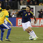 Mario Alberto Yepes, Colombia, takes on Kaka and Oscar, Brazil, during the Brazil V Colombia International friendly football match at MetLife Stadium, New Jersey. USA. 14th November 2012. Photo Tim Clayton