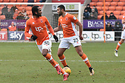 Blackpool Forward, Nathan Delfouneso (30) and Blackpool Midfielder, Colin Daniel (23)  during the EFL Sky Bet League 1 match between Blackpool and Bristol Rovers at Bloomfield Road, Blackpool, England on 13 January 2018. Photo by Mark Pollitt.