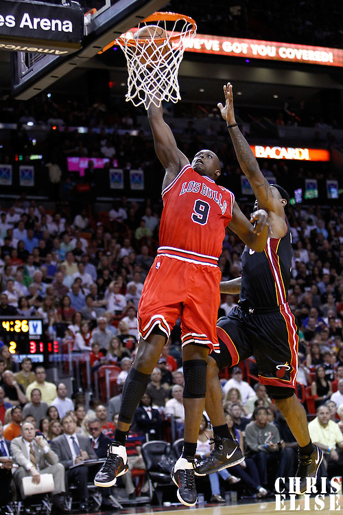 06 March 2010: Chicago Bulls small forward Luol Deng (9) dunks the ball past Miami Heat small forward LeBron James (6) during the Chicago Bulls 87-86 victory over the Miami Heat at the AmericanAirlines Arena, Miami, Florida, USA.