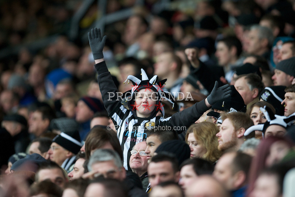 NOTTINGHAM, ENGLAND - Sunday, January 30, 2011: A young Notts County supporter during the FA Cup 4th Round match against Manchester City at Meadow Lane. (Photo by David Rawcliffe/Propaganda)