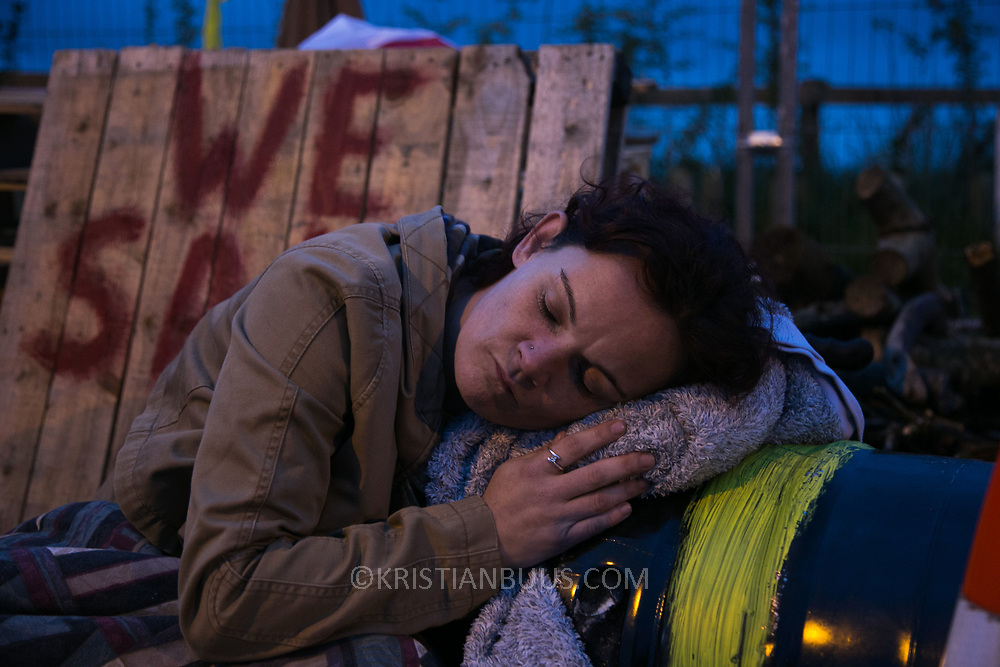 Louise Robinson. Around 4 am. 13 anti-fracking activists, one hour into a joint lock-on outside Quadrilla's drill site in New Preston Road, Lancashire. The campaign against the drilling for shale gas has been going for years and since January 2017 many have taken to block the gates to deny Quadrilla being able to drill. Fracking was rejected by Lancashire County council in 2015 but were overruled by central Conservative government and locals are fighting to stop the drilling and reverse the decision.