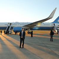 Secret Service members surround Air Force One after it landed at Tupelo Regional Airport on Monday afternoon.