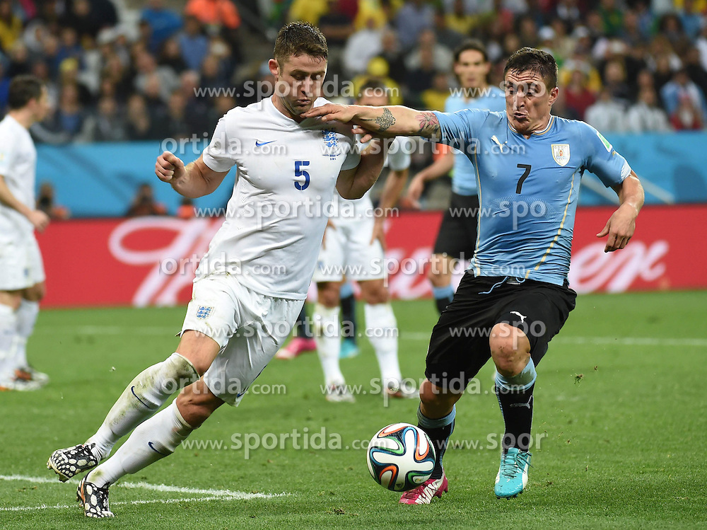 19.06.2014, Arena de Sao Paulo, Sao Paulo, BRA, FIFA WM, Uruguay vs England, Gruppe D, im Bild England's Gary Cahill (L) vies with Uruguay's Cristian Rodriguez // during Group D match between Uruguay and England of the FIFA Worldcup Brasil 2014 at the Arena de Sao Paulo in Sao Paulo, Brazil on 2014/06/19. EXPA Pictures &copy; 2014, PhotoCredit: EXPA/ Photoshot/ Li Ga<br /> <br /> *****ATTENTION - for AUT, SLO, CRO, SRB, BIH, MAZ only*****