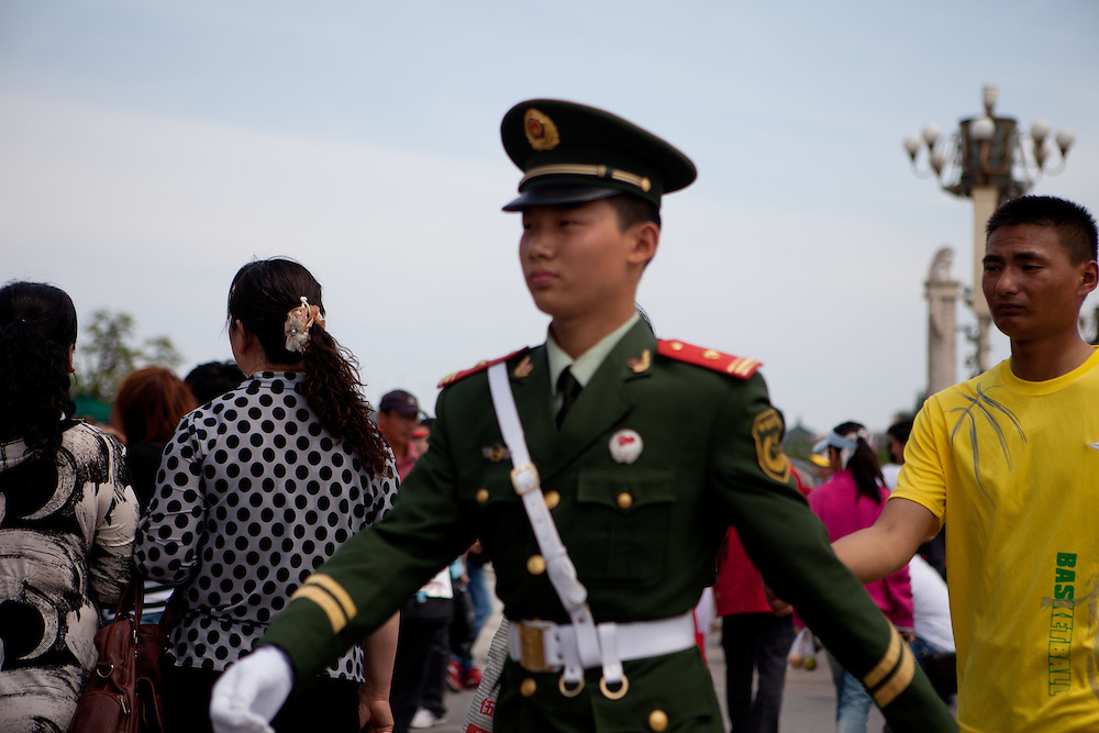 "A police man marching at the entrance to ""The Forbidden City"" which was the Chinese imperial palace from the Ming Dynasty to the end of the Qing Dynasty. It is located in the middle of Beijing, China. Beijing is the capital of the People's Republic of China and one of the most populous cities in the world with a population of 19,612,368 as of 2010."