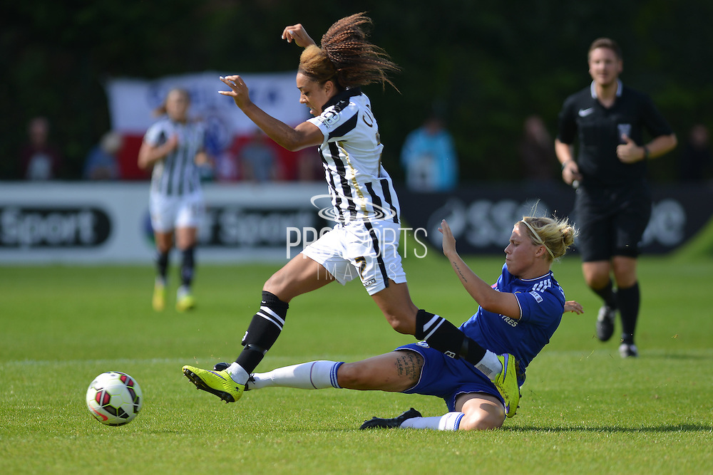 Chelsea Ladies defender Gilly Flaherty tackles Notts County Ladies forward Jess Clarkeduring the FA Women's Super League match between Chelsea Ladies FC and Notts County Ladies FC at Staines Town FC, Staines, United Kingdom on 6 September 2015. Photo by Mark Davies.
