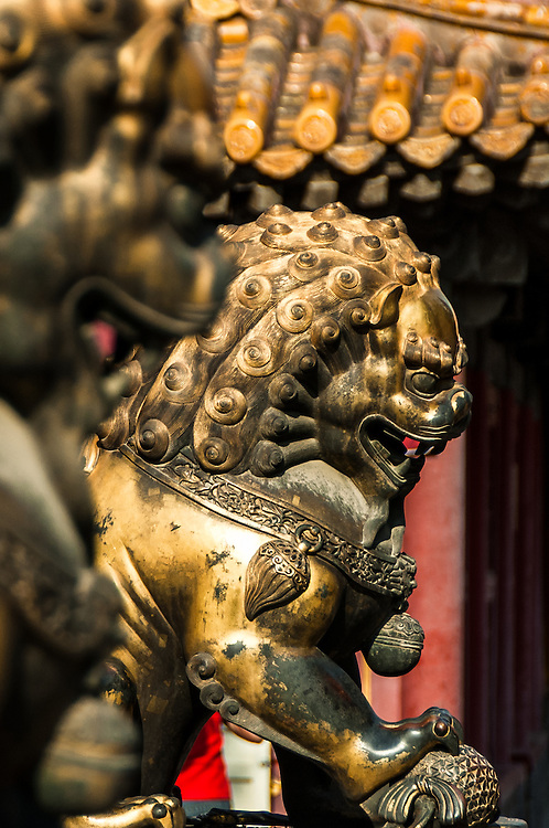 Stock photograph of a guardian lion in the Forbidden City in Beijing